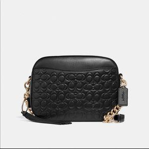 Black coach camera bag with classic c's